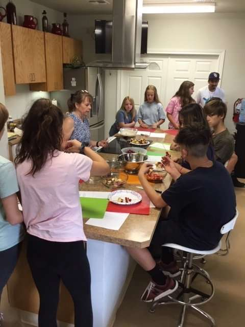 Healthcare Coordinator Susan Broa leading a cooking class for the Boys and Girls Club of Bandera